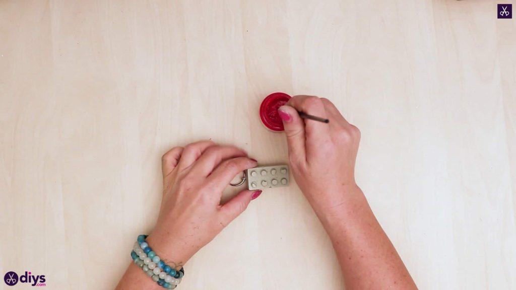 Peinture porte-clés en béton lego block