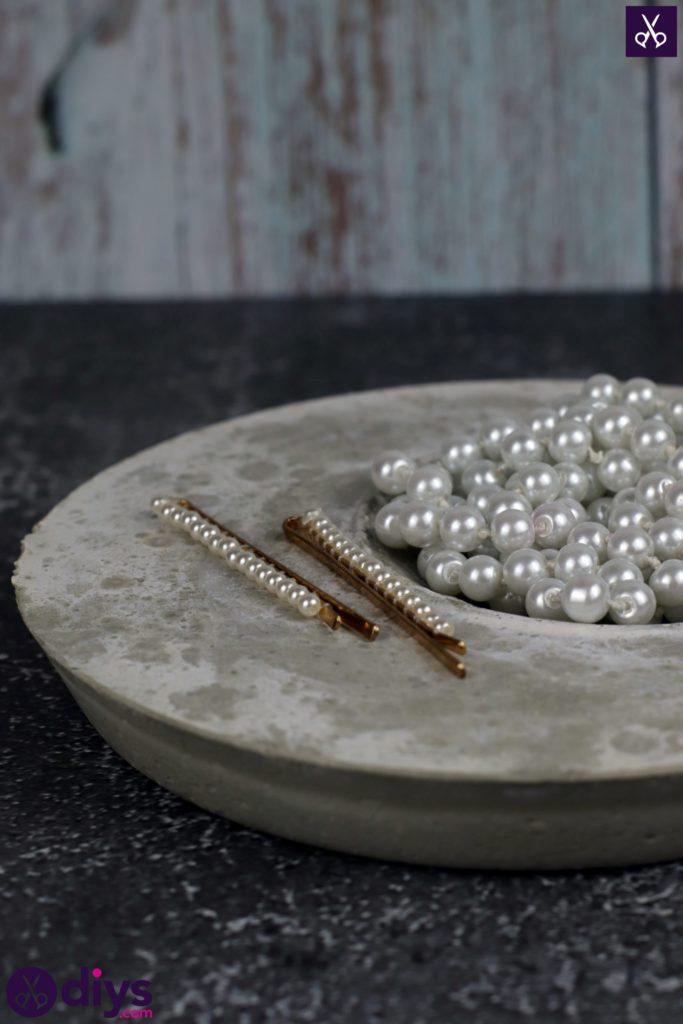 Porte-bijoux en béton bricolage plat cru