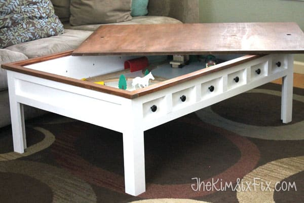 Kid friendly coffee table with car tracks inside