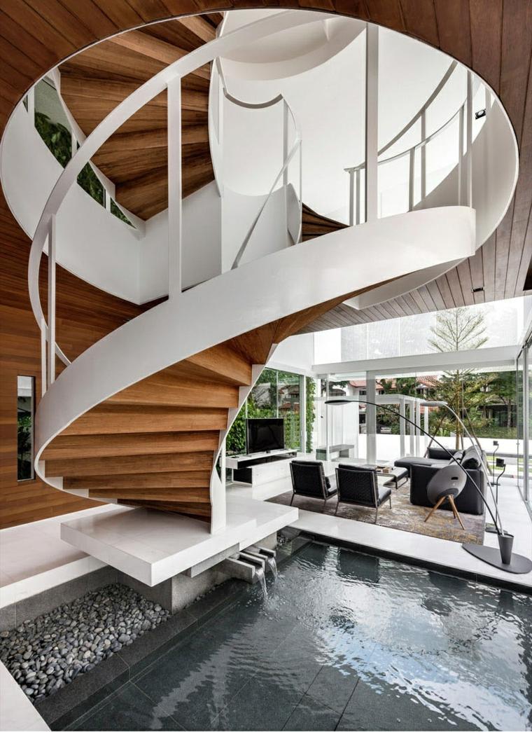 escaliers en colimaçon blancs murs cheminées pièces
