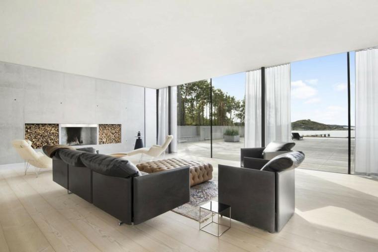 idées de cheminée de plage de maison de mur de béton