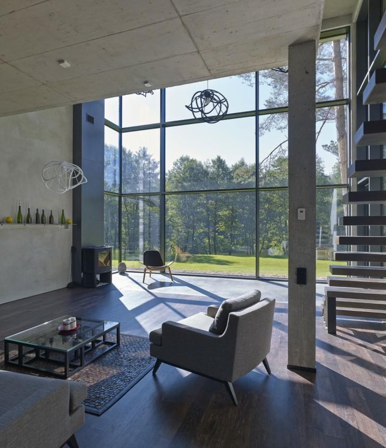 Mur en béton fenêtres de la maison fauteuils gris