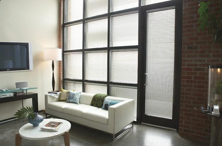 salons design briques sobres coussins industriels