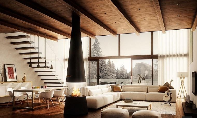 salon ouvert escaliers cheminée canapé moderne grand design