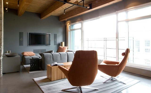 salon design moderne original chaises en cuir orange